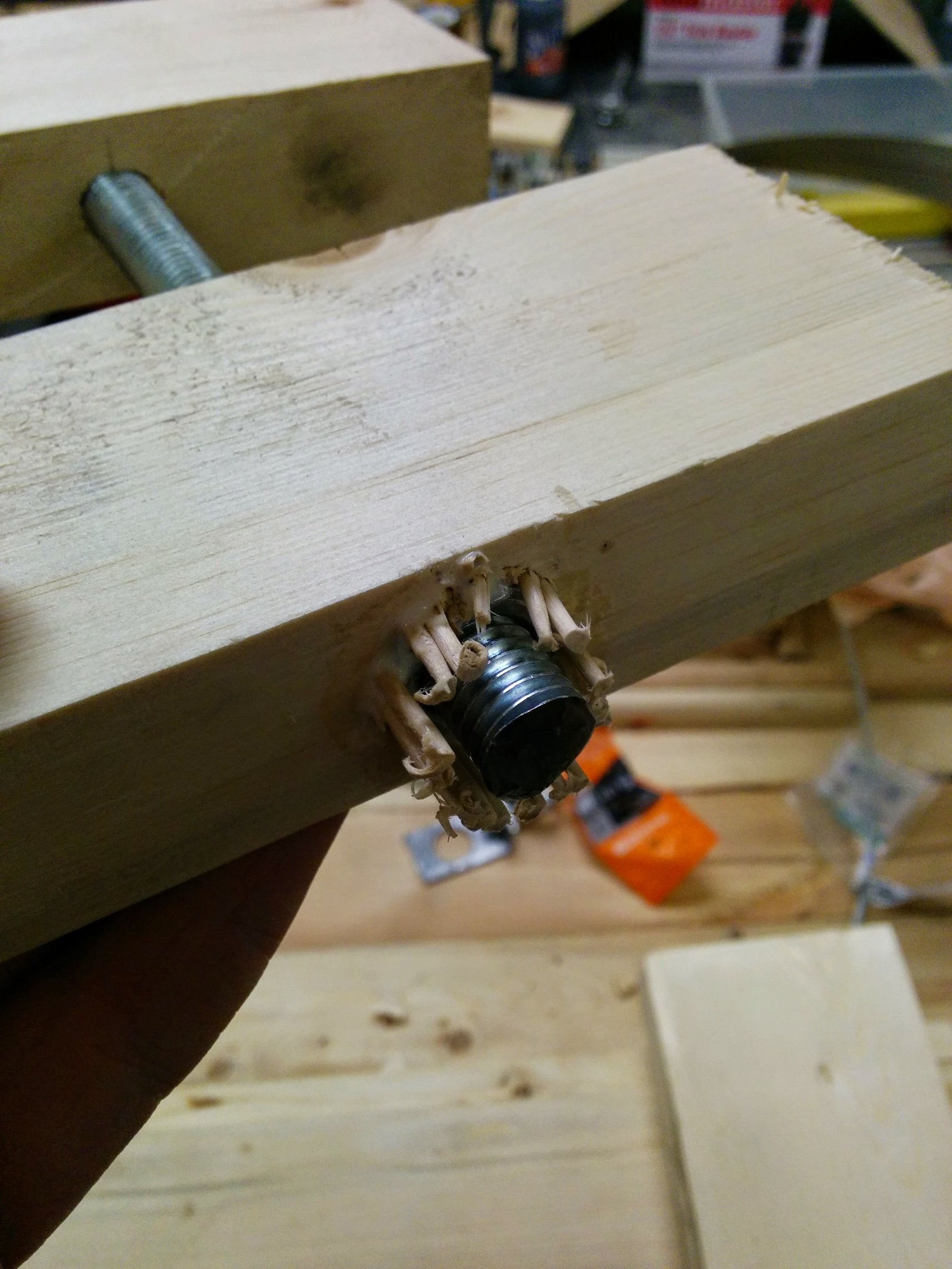 "Cut a 1/2"" hole, then countersunk one end so I could put a 1"" long nut inside. Since I can't cut hexagonal holes, I just filled it with wood glue and toothpicks, this has worked brilliantly so far. Another likely better way to do this (or so I've been told) is to cut a hole that's smaller than the nut, then use a washer to pull the nut into the hole."