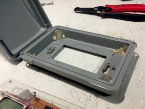 Menard's weatherproof outlet box with acrylic standoffs. Go Gorilla Glue!